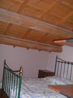 Double bed in family Room, partitioned for privacy