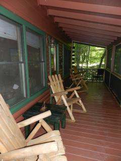 Screened in rocker porch with gas grill