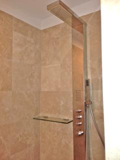 Shower towers installed in both ensuite bathrooms