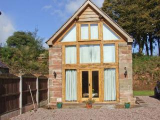 ORCHARD COTTAGE, pet-friendly, private garden, open beams and stonework, near