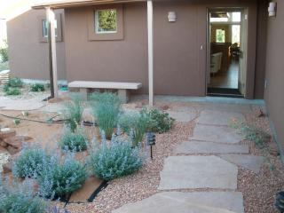 Front entry from landscaped private courtyard garden