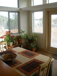 Dining area looking out to rear south-facing garden patio