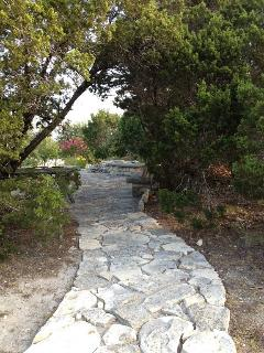 Stone path to cliff-top patio and fire pit.