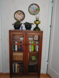 A lovely old vintage cabinet in the larger bedroom