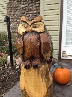 The Wise Owl awaits you on the porch