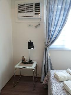 Wardrobe cabinet airconditioner and curtains