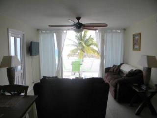 Living room looking out to beach and ocean views
