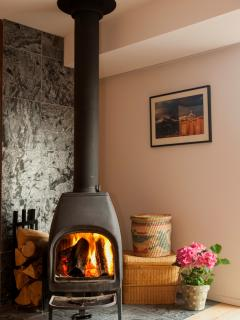 A wood stove in the living room adds warmth to the house in winter.