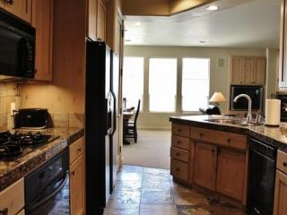 Gourmet Kitchen With Slate Floors And Granite Counter Tops Stocked With Cookware & Dishes