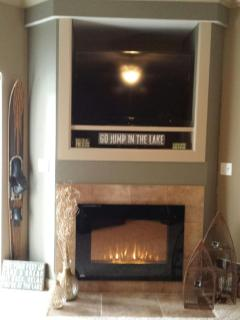 Electric fireplace, TV, DVD player in Living Room area