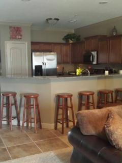 Kitchen view from Living Room; 6 bar stools.