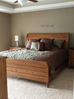 Master Bedroom, lakeside, with king set & ceiling fan.