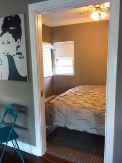 view into second bedroom with king bed