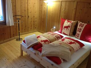 Cosy room fully in pine wood in traditional Engadine style.