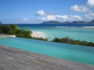 Located on Sandy Point Beach, this new villa incorporates traditional aspects of French West Indies architecture. RIC SHU, St. Maarten/St. Martin