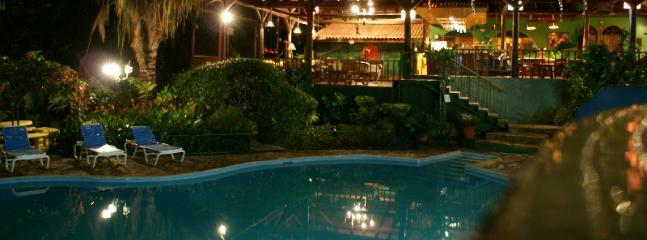 The pools and villa at night