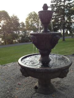 Lion head fountain in front yard overlooking Cayuga Lake