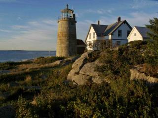 Working Lighthouse on Picturesque Island in Maine