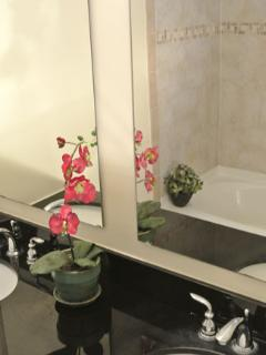 Bathroom #3:  Garden Level.  Double sink vanity with granite.  Tiled shower / tub & heater.