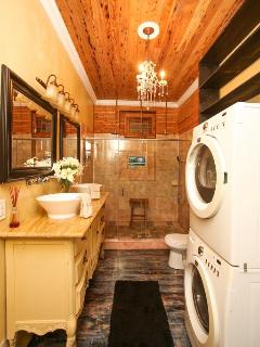 Red Room ensuite bath with huge walk-in shower w/ 6 heads, antique dual vanity, front load wash/dry