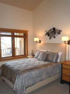 The second bedroom offers beautiful views and a flat panel TV.