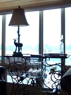 Lamp & wine rack at picture window