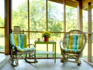 Lonnie's outdoor screened in porch looking at water