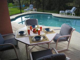 Poolside dining, enclosed lani with fan.