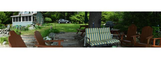View of yard from deck - glider has beautiful natural umbrella from the old big hemlock tree