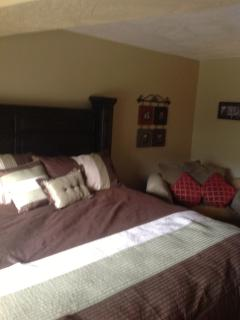 downstairs bedroom with king size bed and the most perfect reading chair!