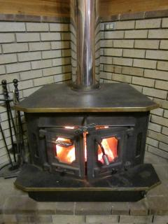 Love the wood stove fireplace!