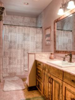 Guest bathroom.  Travertine, tile, custom cabinets.