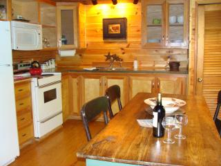 Spacious modern kitchen with large farm table for 4