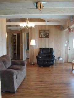 Living room, east side; doors on left to bathroom & bedrooms