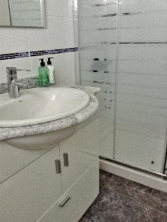 NEW!! Bathroom with walk in rain & power shower and marble vanity unit
