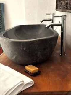 Master bathroom sink carved from solid river stone with fixtures for 2