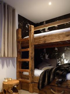 Cosy cow hide triple bunk bedroom