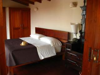 Master bedroom with King-sized bed, double shower bathroom and balcony overlooking courtyard