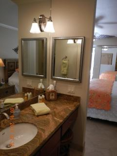 Master bath with granite counter & cherry wood cabinets w/ vanity area