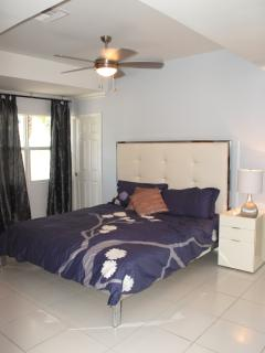 Master bedroom with King size bed, large walk-in closet and ensuite bathroom