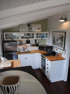 Kitchen showing beamed ceilings