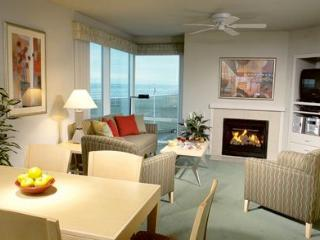 Living room has queen Murphy bed, gas fireplace, balcony with BBQj, TV/DVD player, ceiling fan.