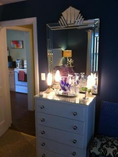 Dresser with art deco mirror and 1920's boudoir lamps.