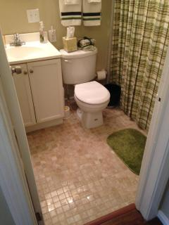 Travertine tile bathroom floor.