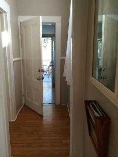 See Bathroom door on the left of this pic.... looking through laundry/entrance from Kitchen