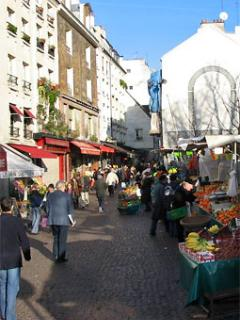 Rue Mouffetard - its food stores - one the oldest streets of Paris (and a Woody Allen favourite)