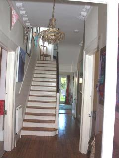 Our elegant hallway with stripped wooden floors.