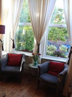 In the bay window there are a couple of comfy chairs for you to relax in.