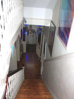 Here is our beautiful hallway looking down from the first floor.