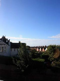This is the view from the balcony, in the far distance you may be able to see the sea on a clear day